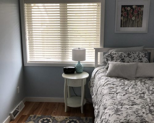 Hunter Douglas white wood blinds bedroom